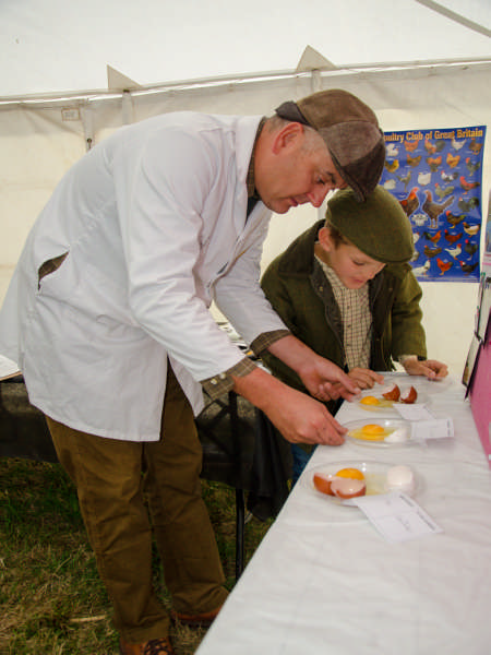 Alan Brown and son judgeing eggs